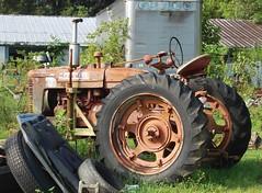 Farmall Tractor (robgividenonyx) Tags: kentucky tractor farmall abandoned rusted ruraldecay faded