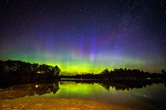Geomagnetic Magic (Matt Molloy) Tags: mattmolloy photography auroraborealis northernlights colourful night sky stars green red blue purple calm water reflection trees house light haskinspoint littlecranberrylake seeleysbay ontario canada landscape nature lovelife