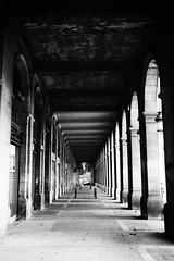 Barcellona's Portico (l.cutolo) Tags: blackandwhite urban onone worldtrekker city tlp symmetry barcelona bw spain street arcs shadow travel lights