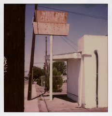 White Rose Cleaning Co. (tobysx70) Tags: the impossible project tip polaroid sx70sonar sonar instant color film for sx70 type cameras impossaroid white rose cleaning co west valencia drive fullerton orange county california ca ghost sign faded rust rusty oxidized utility power pole vanishing point toby hancock photography