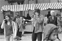Phones, Hats and Candyfloss (h_cowell) Tags: film filmphotography filmisnotdead believeinfilm grain grainy candid street streetphotography blackandwhite mono monochrome people crowd cosina hanimex appicoftheweek macclesfield treaclemarket