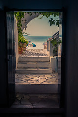 Welcoming View (A & A McKee) Tags: nikon d500 1835 18 sigma door sea beach umbrella greece crete loutro sfakia water blue summer sky stairs plants landscape