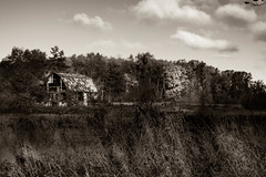 It happened out back by the Barn... (Grant in Ontario) Tags: farm barn bw black white landscape field dark shadow d5200 nikon gloomy scary foreboding
