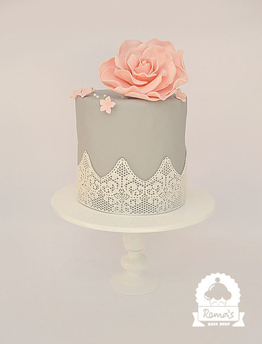 Elegant lace and floral wedding cake