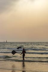 End of Shift (Ivona & Eli) Tags: sky rays light sunset waves israel summer beach mediterranean sea flags lifeguard man work