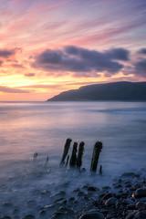The Porlock Four (Geoff Moore UK) Tags: sunrise morning sea ocean water tide beach clouds stumps woodstumps dawn dusk longexsposure rocks movement waves