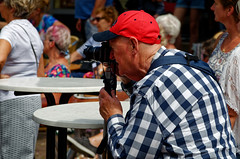 The Red Cap Snapper (Alfred Grupstra) Tags: people cultures editorial men crowd street outdoors travel women senioradult urbanscene groupofpeople