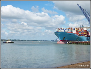 Tug 'Svitzer Shotley' pulling the 'Evelyn Mersk' away from the quay