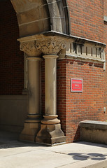 Columns, University Hall, Ohio State University — Columbus, Ohio (Pythaglio) Tags: university hall building structure facsimile 1976 ohio state osu columbus franklin county romanesque brick plaque placard arch voussoirs columns round plinths ornate capitals floral sidewalk 1874