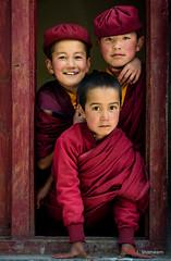 Merry Maroon Monks (Shameem Shah) Tags: 3 portrait monk street ladakh travel india innocence monastery leh kids three frame shutterarts red innocent kid