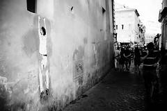 No one's helping (lorenzoviolone) Tags: art bw black white finepix fuji x100s fujifilm monochrome rni films tourism artistic cobblestone mirrorless rome sticker streetphoto streetphotobw streetphotography walk:rome=june292017 walking wall blackwhite blackandwhite fujix100s fujifilmx100s rnifilms stickerart roma lazio italy