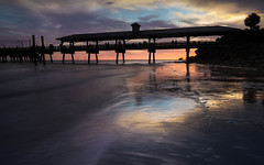 Twilight Fishing (Charles Opper) Tags: canon georgia neptunepark stsimonsisland atmosphere clouds coast color dusk landscape light mood nature pier reflection seascape shore silhouette sunset twilight water waves