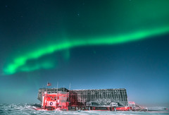 Aurora over South Pole Station (redfurwolf) Tags: southpole antarctica southpolestation auroraaustralis aurora nightsky night stars building architecture sky snow ice nature outdoor landscape redfurwolf sonyalpha sony a99ii sal1635f28za