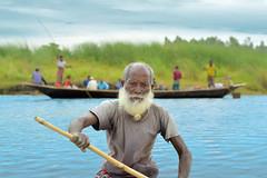 Boatman (mrh_enan) Tags: boat river boatman livelihood village man old nikon d5200