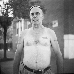 (patrickjoust) Tags: twin lens reflex tlr 120 6x6 medium format black white bw home develop film blancetnoir blancoynegro schwarzundweiss manual focus analog mechanical patrick joust patrickjoust west baltimore maryland md usa us united states north america estados unidos urban street city people person man portrait standing no shirt chevy tattoo sun glasses