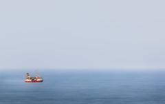 Open Water (Inge Vautrin Photography) Tags: boat red hirtshals denmark danmark thenorthsea vesterhavet vestkysten ocean sea hav art artistic blue sailing traveling openwater water europe europa jylland jutland