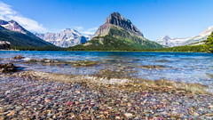 Many Glacier (leah.kling) Tags: lake lakes water reflection rocks glacier national park mountain mountains color canon weather landscape photo photography flickr tokina wide angle low shot texture forest montana usa us explore adventure hike trail nature natur sky blue cloud clouds serene
