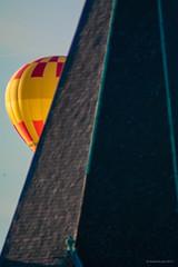 Hot air balloon (emcekah) Tags: 200mm 400mm albinar heissluftballon herzjesu kirche sammelimport972017 tokina turm versteck ballon dach sunlight tele teleconverter unscharf vintage
