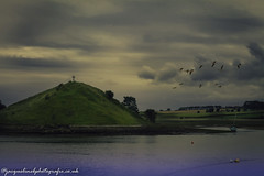 holy places : Northumberland Alnwick. Low tide in the estuary (drjacquebaxter) Tags: northumberland northeast northsea jacquelinebphotografiecouk jacquelinebaxter sea holy cross sacredspace sacred st cuthbert alnmouth birds sun sky moody