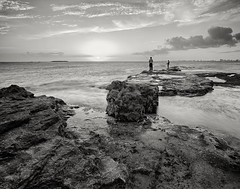 Fishing during low tide (Eddie La Mole) Tags: piñones bocadecangrejos fishermen beach sea waves sunset pentax6x7 smc45mm kodakektar