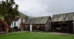 Colonial Cottages (Jocey K) Tags: newzealand nikond750 southisland bankspenisnsula spring maoricolonialmuseumokainsbay museum landsape sky clouds mist hills cottages building architecture cabbagetrees okainsbay