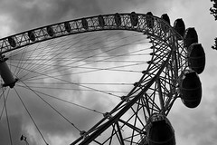 Look up the Eye (B/W) (DaveJC90) Tags: london capital city skyline building architecture england uk unitedkingdom britain black white blackandwhite bw colour colours sun sunny sunlight light bright sky blue cloud cloudy dark shadow dull grey rain rainy day holiday londoneye bridge shard gherkin tower42 skyscarper tower tall stpauls cathedral viewing gallery view landscape river thames water old new classic modern crop croped nikon d5100 digital slr camera lens zoom 1855mm iphone iphone6 mobile phone detail sharp sharpness