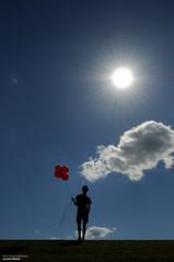 Stand (disgruntledbaker1) Tags: disgruntledbaker umbrella sun cloud balloons