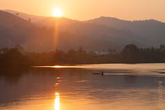 Sunset at Teuk Chhou river (yuriye) Tags: yuriye cambodia teuk chhou river water canoe boat reflection asia sun sunset mountain tree green house greenhouse ray rays hill kampot landscape outdoor harmony evening prek khmer siluette