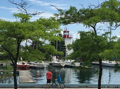 Hi from Toronto! (peggyhr) Tags: peggyhr humberbaypromenade lighthouse lakeontario toronto ontario canada boy man trees marina
