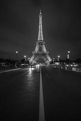 Red Light Go! (gimmeocean) Tags: eiffeltower paris france night handheld bw blackandwhite vertical vert