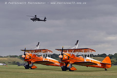 2102  Apache over Stearmans (photozone72) Tags: raf cosford aviation airshows aircraft airshow canon canon100400mmf4556l canon7dmk2 7dmk2 apache aac army armyaircorps helicopter rotors boeing stearman biplane breitlingwingwalkers breitling