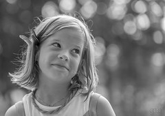 Charlotte (lgflickr1) Tags: park portsmouthvirginia blackandwhite nikon d700 bokeh child girl bw feather cute innocent blond smile young good