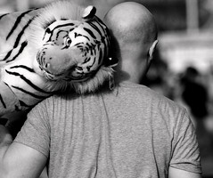 Man with tiger on his shoulder (The Real Silver Surfer) Tags: brighton blackandwhite monochrome streetphotography stuffedtoy