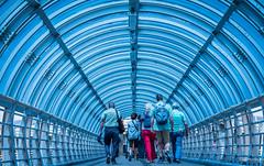 2017 - Korea - Jeju City - 11 of 12 (Ted's photos - For Me & You) Tags: 2017 cropped jeju korea nikon nikond750 nikonfx southkorea tedmcgrath tedsphotos vignetting walkway coveredwalkway jejukorea people peopleandpaths backpack railing