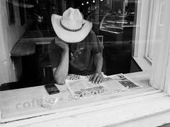 Cowboy         Hat (Mark Ittleman) Tags: cowboy hat santafe nm storefront cowboyreading
