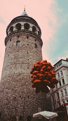 Somebody loves somebody. (hülyaçam) Tags: galata istanbul turkey balloon love red streetphoto street people tower build perspective color