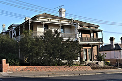 Punt Road Terrace IV - Melbourne (IDH Mackinnon) Tags: punt road rd south yarra terrace house homes building architecture architectural motif lattice wrought iron verandah melbourne victoria victorian australia australian aussie id hearn mackinnon photographer old fading historic era inner city urban 1880 1800s nineteenth 19th century 2017 brick
