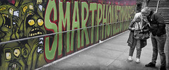smartphone zombies (Daz Smith) Tags: dazsmith fujixt20 fuji xt20 city streetphotography people candid portrait citylife thecity urban streets uk monochrome graffiti art mural smartphone zombies bearpit bristol