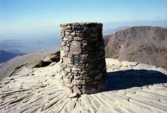 Yr Wyddfa trig pillar (Jeff Buck) Tags: snowdon snowdonia snowdonianationalpark summit summitofsnowdon mountainsummit 35mmfilm canonae1program 28mmlens fujicolorsuperiaxtra400