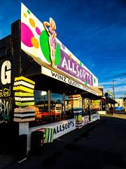 Allsorts (Steve Taylor (Photography)) Tags: art sign logo shop colourful fun lady woman newzealand nz southisland canterbury christchurch autumn sunshine sunny liquoriceallsorts allsorts 374ferryrd sweets secondhanddealer junkshop