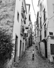 Measure (thomasthorstensson.photography) Tags: composition sohinzo lisbon streetphotography beco google explore playing xf23mm14r alfama urban cobblestones monochrome may day alone 2015 fujifilmxt1 local backstreet human candid document alley amalgam anatomy bw blackandwhite blend borough candidphotography citified city consider daylight daytime detached fallible forlorn frank free mortal pathway probe solo structure town urbanphotography