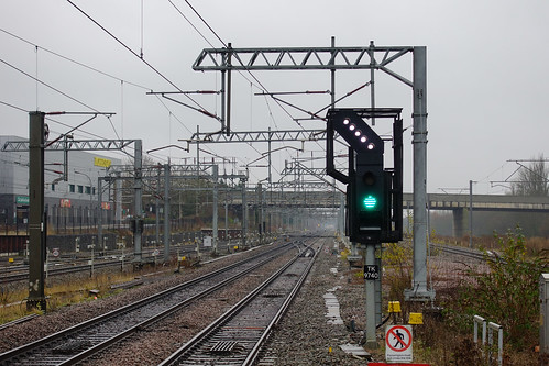 Wires and rails and a green signal