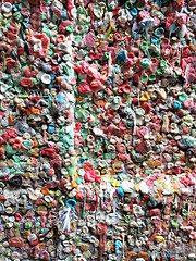 Seattle's gum wall (Ruth and Dave) Tags: gumwall pikeplace alley seattle wall gum chewinggum bubblegum graffiti sticky disgusting gross weird cool covered feather