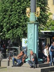 Men seated at a flagpole, Gustav Adolfs torg, Gothenburg, Sweden (Paul McClure DC) Tags: gothenburg sweden sverige july2015 göteborg historic architecture people