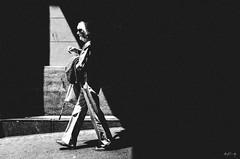 triangles (matthias hämmerly) Tags: candid street streetphotography shadow contrast grain ricoh gr black white bw monochrom monochrome city town urban blackandwhite strasse people monochromphotography einfarbig personen silhouette zuerich sun evening sunbath triangle woman hb station light beam lightbeam zürich switzerland swiss