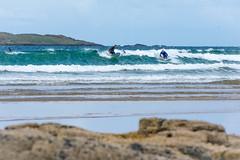 Sun out, fun out (skippyjon2010) Tags: portrush surf surfer wind wave waves green sand rocks water salt atlantic island saltwater surfing