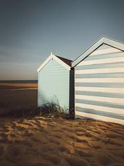 The Blue Huts (Nick Seaman Photos) Tags: suffolk visitsuffolk eastanglia sony sonyemount sonya7r2 sonya7rii sonya7r zeiss leefilters leefilter variotessartfe41635 sunset sun beach beachhut beachhuts beachy sand sandy sandripples variotessar stripes blue