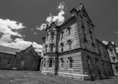 Castle Draped in Clouds (trainmann1) Tags: nikon d90 tokina 1116mm amateur handheld transalleghenylunaticasylum lunaticasylum westonstatehospital statehospital hospital weston wv westvirginia summer june 2017 historic vintage building blackwhite blackandwhite bw desaturated rusty crusty rust crust abandoned neglected wideangle