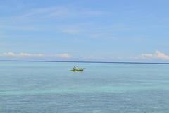 Lone Boatman (rica1786) Tags: philippines ocean boat boatman