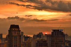 Sail into the sunset (Sumarie Slabber) Tags: sunset light evening manila philippines sumarieslabber buildings clouds sky sun nikon